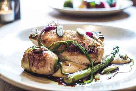 The Milestone - Two course Sunday lunch for two with a glass of wine each - Save 56%