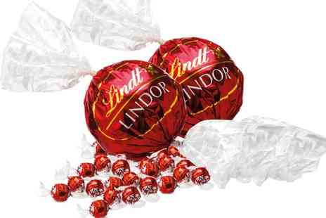 Groupon Goods Global GmbH - 1.1KG of Lindor Lindt Chocolate And Two 550g Maxi Balls - Save 72%