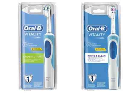 Groupon Goods Global GmbH - Oral B Vitality Cross Action or White and Clean Toothbrush with Optional Plug - Save 54%