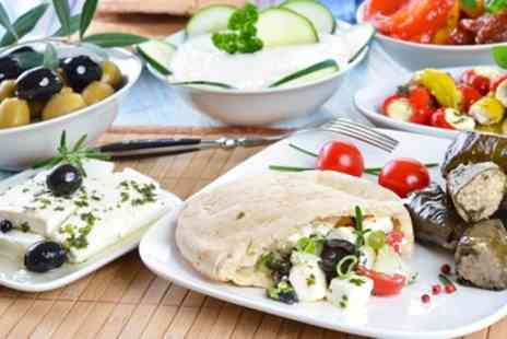 Niks Greek Taverna - Meze Banquet with a Glass of Wine for Two or Four - Save 57%