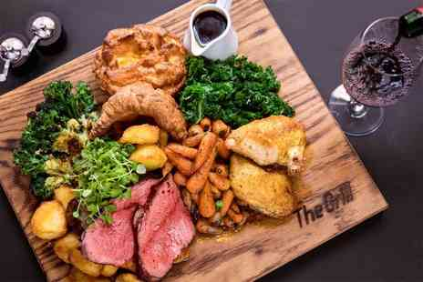 McQueen - Choice of superb Sunday roast with a glass of wine each for two - Save 52%