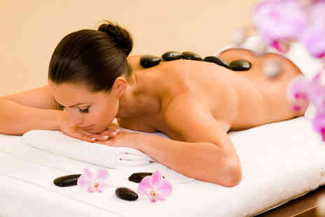 Healthy Retreat - Spa day for one person with a hot stone massage, taster facial and glass of bubbly and spa access - Save 0%