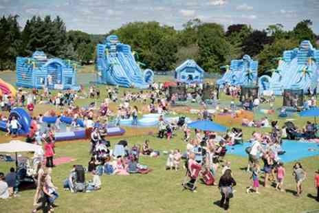 Fantastic Inflatable World - Fantastic Inflatable World Ticket for One Person or a Family of Five - Save 21%