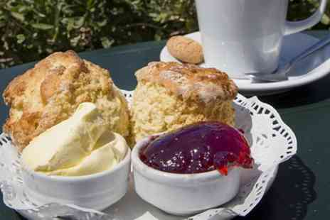 Sweet Cottage Tea Rooms - 1940s Themed Cream Tea for Two or Four - Save 41%