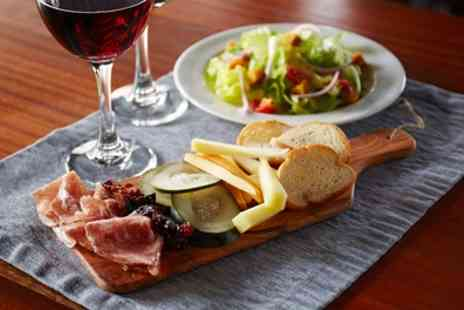 Churchills Bar - Three Tapas and Glass of Wine Each for Up to Six - Save 61%