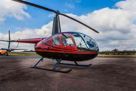 Flying Pig Helicopters - Unforgettable helicopter flying experience for two with Flying Pig Helicopters - Save 0%