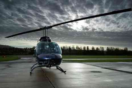 Whizzard Helicopters - 20 Mile Helicopter City Tour for One or Two - Save 41%