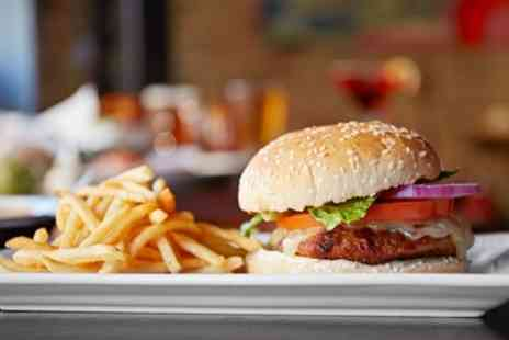 Komedia - Two or four tickets to Saturday Comedy Night with a burger on 9 September To 14 October - Save 58%
