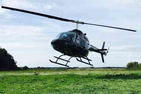 Adventure 001 - Six mile helicopter buzz flight for two with chocolates and a glass of bubbly each - Save 50%