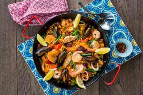 La Tasca Restaurant - Paella or Main Dish with Choice of Drink for Two or Four - Save 52%