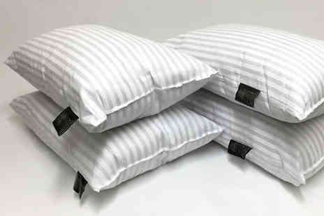 Home Furnishings Company - Four hotel quality striped pillows - Save 80%