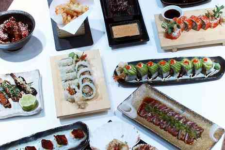 Inamo - Eight course interactive dining experience for two people including a glass of fizz each dine - Save 50%