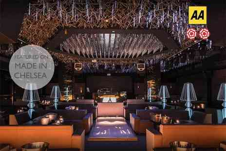 DSTRKT - Three course dining for two with a sparkling cocktail and club entry each - Save 72%