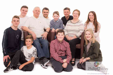 "Philip Charles Photography - One hour family photoshoot for up to 20 including three 7"" x 5"", two 10 x 8"" prints and a £50 voucher - Save 96%"