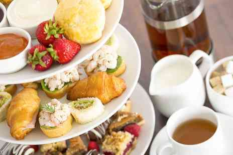 Stade Court Hotel - Festive Afternoon Tea with Glass of Prosecco for Two or Four - Save 45%