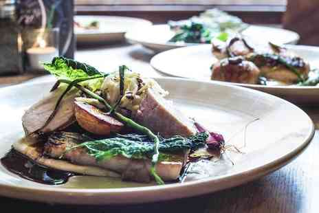 The Milestone - Two course Sunday lunch for two people with a glass of wine each - Save 60%