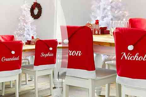 Treats on Trend - Two personalised santa hat chair covers - Save 60%