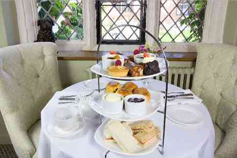 Seckford Hall Hotel and Restaurant - Champagne Afternoon Tea for Two or Four - Save 0%