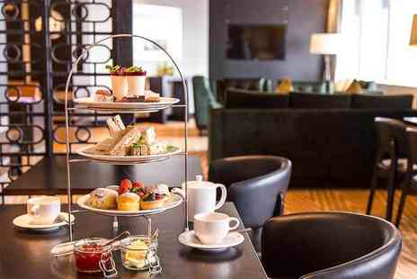 Hilton Canary Wharf - Afternoon tea for two with a bottle of bubbly to share - Save 52%