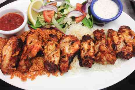 Rojava Restaurant - Mixed Barbecue Dinner and Dessert for Two, or Rojava Dinner for Three or Four - Save 34%