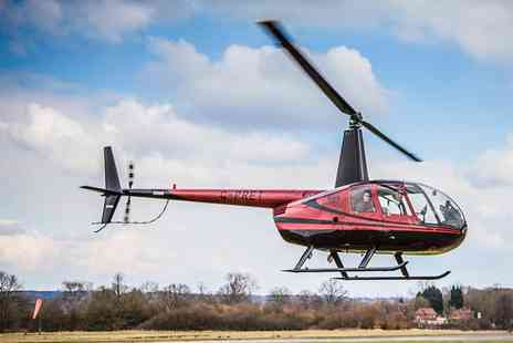 Flying Pig Helicopters - Helicopter Flying Lesson for One or Two or a Private Lesson for Three - Save 50%