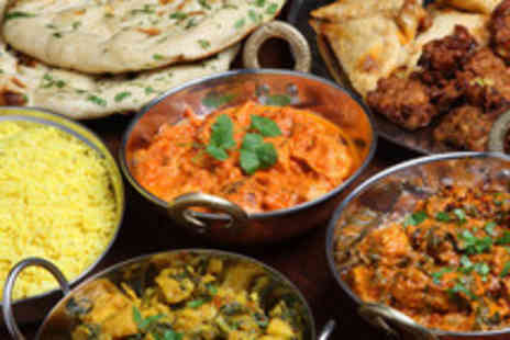 Raj Restaurant - An Indian meal for 2 including starters, mains, sides and glass of wine or beer - Save 60%