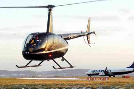 Helicentre - Six mile private helicopter flight for two including a glass of Prosecco each, chocolates and a rose - Save 0%