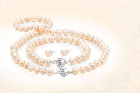 Pearl Shed - Peach freshwater semi baroque pearl tri set - Save 88%
