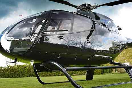 Helicentre - Five minute private helicopter flight for two including a glass of Prosecco each and flowers for mum - Save 0%
