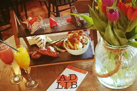 Ad Lib - New York themed afternoon tea for two with a Bellini cocktail each - Save 58%