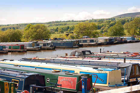 Reedley Marina - 60 minute Leeds and Liverpool canal cruise with afternoon tea in a picnic basket and a glass of Prosecco each for two - Save 58%