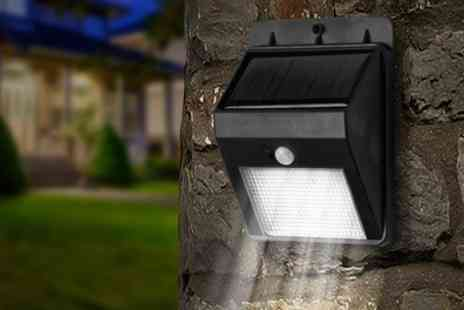 Groupon Goods Global GmbH - One, Two or Four Sets of Super Bright LED Solar Powered Motion Sensor Lights - Save 75%