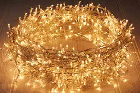 Groupon Goods Global GmbH - Up to 600 Indoor or Outdoor Plug in Warm White LED String Lights with 8 Light Effects - Save 60%