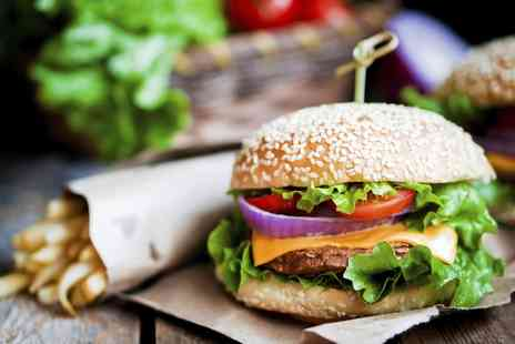 Solo Restaurant - 12oz Beef Burger with Sides and Soft Drink or Bottle of Beer for Two or Four - Save 50%