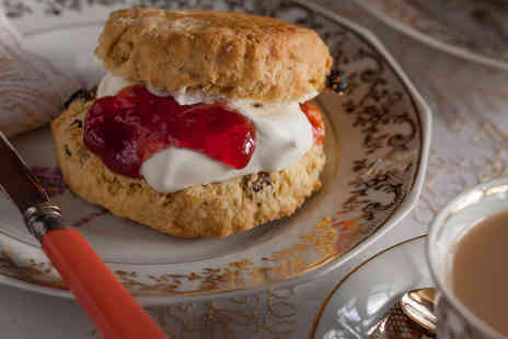 Rambling Rose Restaurant - High tea for two with a main course, tea and scones each - Save 38%