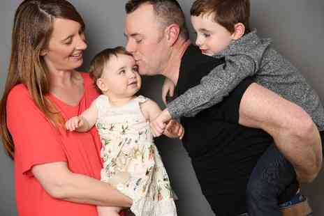 Hammonds Photography Studio - Family photoshoot & £100 voucher towards print pack album digitals or wall product - Save 91%