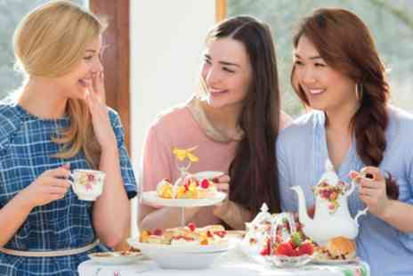 London Epping - Deluxe Afternoon Tea for Two or Four - Save 30%