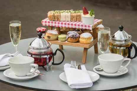 DoubleTree By Hilton - Best of British afternoon tea for two with a bottle of bubbly at the Urban Meadow Cafe & Bar - Save 60%