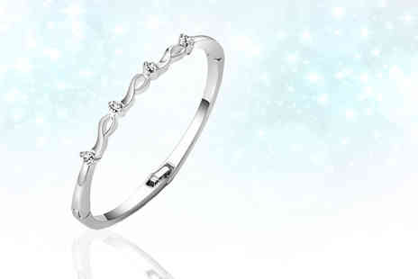 Your Ideal Gift - Four stone rhodium plated bangle made with crystals from Swarovski - Save 91%