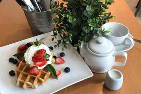 Octavos Book Cafe Wine Bar - Choice of Belgian Waffle and Hot Drink for One, Two or Four - Save 41%