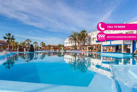 Super Escapes Travel - Five or seven night all inclusive getaway with return flights - Save 39%