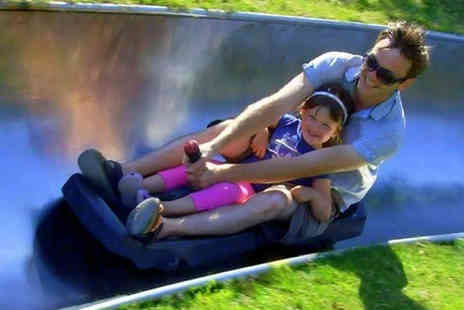 Swadlincote Ski Slope and Snowboard Centre - Slide, ride and drop session for two people including 30 minutes sno tubing, two toboggan rides and three drop slides - Save 60%