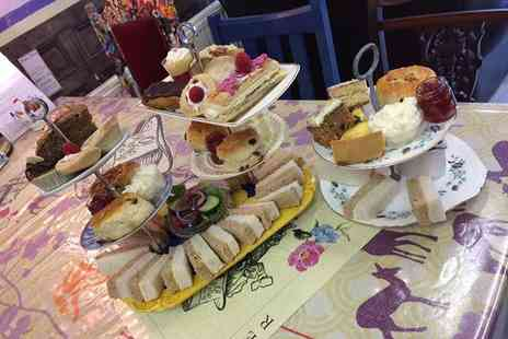Mad as a Hatter - Afternoon tea with trifle for two - Save 36%