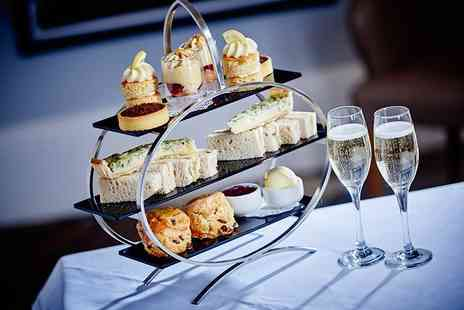 Marco Pierre White Steakhouse Bar & Grill - Afternoon tea for two people with a glass of Prosecco each, or upgrade for a glass of Champagne or Bellini - Save 22%
