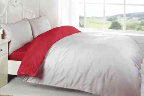 Groupon Goods Global GmbH - Four Piece Reversible Duvet Set in Choice of Colour and Size - Save 71%