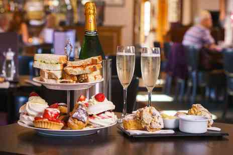 Leo Cafe - Afternoon tea for two people with a glass of Prosecco each - Save 50%