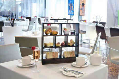 The Hilton Hotel - Afternoon tea for two people or upgrade for a glass of Prosecco each - Save 42%