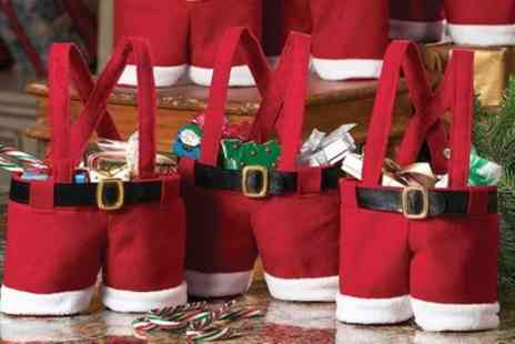 Groupon Goods Global GmbH - Up to Ten Santa Pants, Snowman or Elf Christmas-Themed Bags - Save 70%