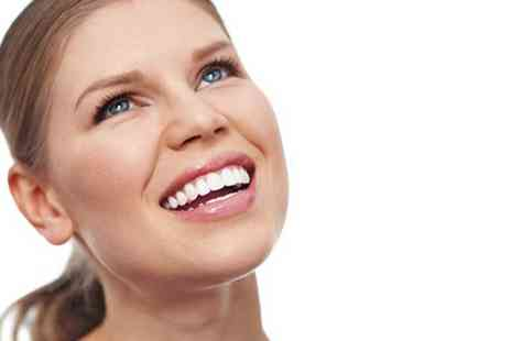 NW1 Dental Care - One or two teeth whitening treatment with a dental examination - Save 79%