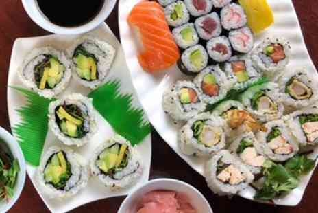 Sushi Aki - Platter with Up to 64 Pieces of Sushi and Optional Hot Food for One or Two - Save 48%